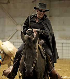 The owner dressed as Zorro on his mule at a Long-Ears Show